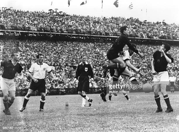 Max Morlock of West Germany goes for the ball during the FIFA World Cup Final against Hungary played in Berne, Switzerland. West Germany won the...