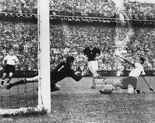 Max Morlock of West Germany scores his countries first goal of the match to get them back in the game during the FIFA World Cup Final against Hungary...