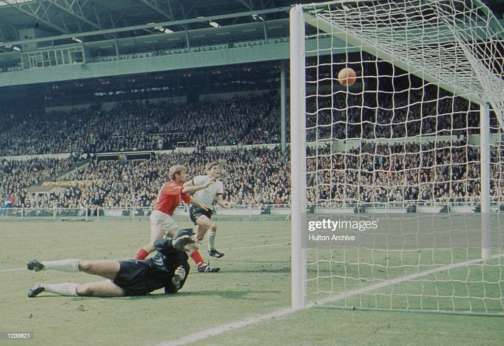 World Cup Final, England v West Germany (4-2 aet). Fourth in the sequence showing England's controversial third, Hurst's second, goal. The ball bounces back out of the goal, as the German ''keeper Hans Tilkowski is beaten. Mandatory Credit:Allsport Hulton/Archive