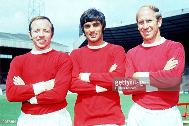 Nobby Stiles George Best and Bobby Charlton of Manchester United pose for the cameras at Old Trafford in Manchester England Two months earlier the...