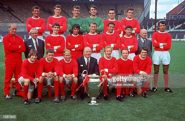 The Manchester United squad including George Best, Bobby Charlton, Nobby Stiles and Dennis Law line up with manager Matt Busby and the European Cup....