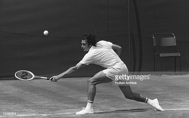 Roger Taylor English Tennis player seen at full stretch during his quarterfinal match on centre court against the Wimbledon debutant Swede Bjorn Borg...