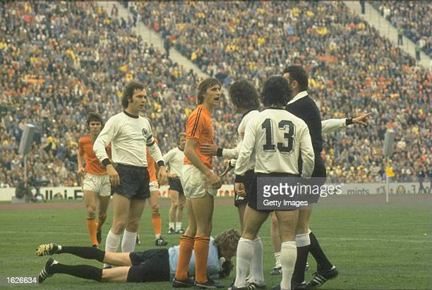 Johan Cruyff of Holland argues with the referee Jack Taylor of England during the 1974 World Cup final match between West Germany and Holland at the...