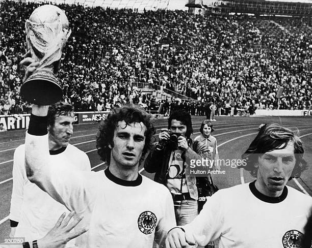 West Germany players lift the trophy after winning the FIFA World Cup Final against Holland played at the Olympic Stadium in Munich Germany West...