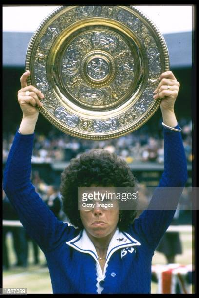 Billie Jean King of the USA holds aloft the Wimbledon ladies singles trophy after winning the title at the all England club in London Mandatory...