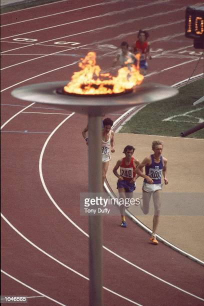 A view of the Olympic Flame with runners in the background at the 1976 Olympic Games in Montreal Canada Mandatory Credit Tony Duffy /Allsport