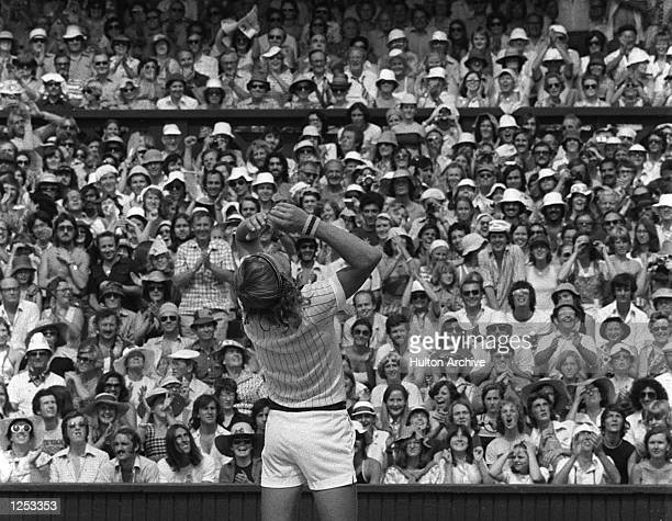 Bjorn Borg throws his racket into the air after beating Ilie Nastase 64 62 97 to become Wimbledon Mens Singles champion Mandatory Credit Allsport...