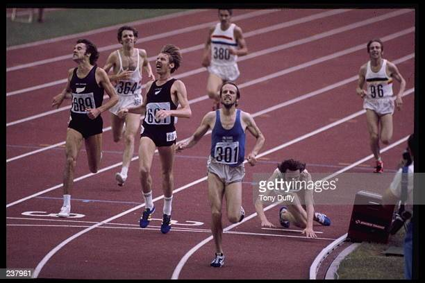Lasse Viren of Finland crosses the finish line to win the gold medal in the 5000m with a time of 132476 during the 1976 Summer Olympics in Montreal...