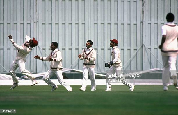 General view of the players in action during the Third Test match between England and the West Indies at Old Trafford in Manchester England The match...