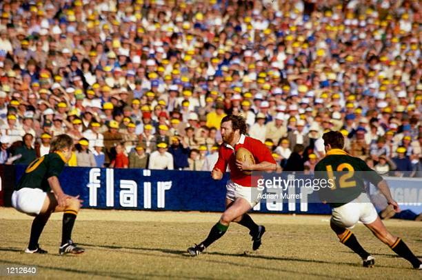 Ray Gravell of the British Lions and Wales races towards the South African defence during the 4th test played in Pretoria South Africa Mandatory...
