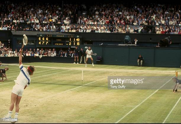 John McEnroe of the USA serves during his match against Bjorn Borg in the finals of the 1981 Lawn Tennis Championships at the AllEngland Club in...