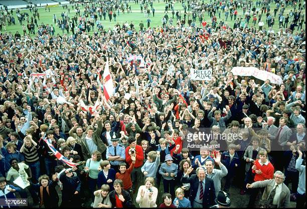 Jubilant fans invade the pitch after England's historic victory in the Third Ashes Test match against Australia at Headingley in Leeds England...