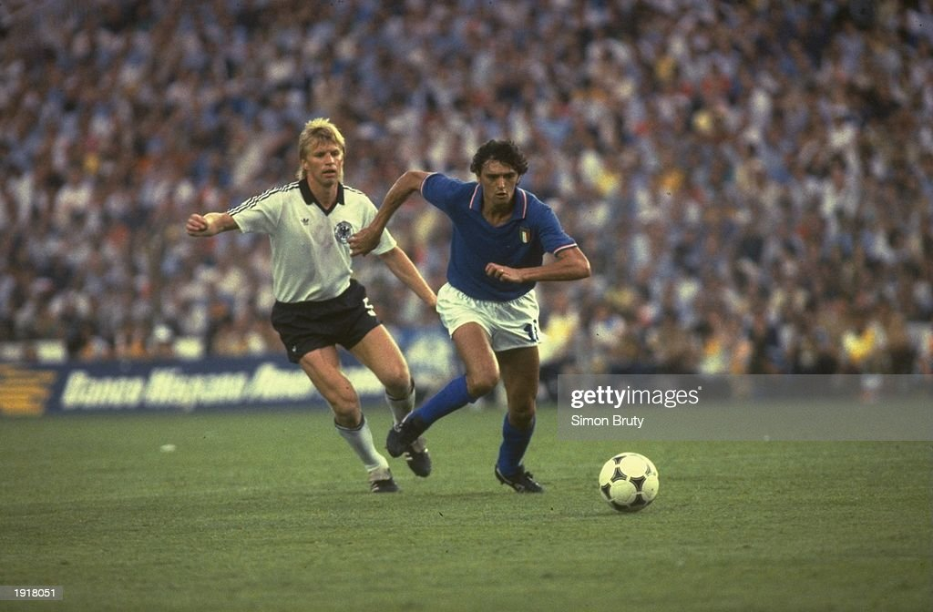 Alessandro Altobelli (right) of Italy beats Karl-Heinz Forster (left) of West Germany to the ball during the 1982 World Cup final at the Bernabeu Stadium in Madrid, Spain. Italy won the match 3-1. \ Mandatory Credit: Simon Bruty/Allsport