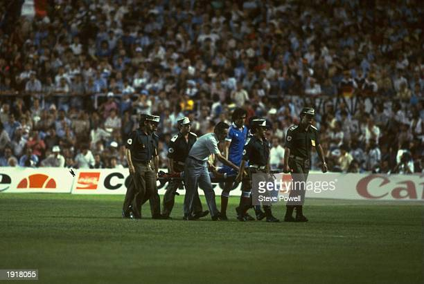 Battiston of France is stretchered off after a tackle by Harald Schumacher of West Germany during the 1982 World Cup semifinal match at Sanchez...