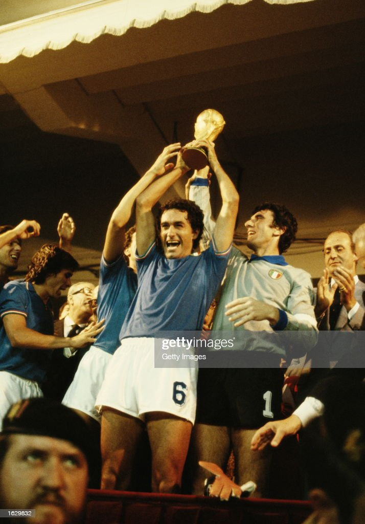 Claudio Gentile #6 and Dino Zoff (right) both of Italy hold the cup aloft after their victory in the World Cup final against West Germany at the Bernabeu Stadium in Madrid, Spain. Italy won the match 3-1. \ Mandatory Credit: Allsport UK /Allsport