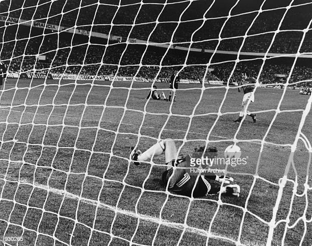 Harald Schumacher of West Germany saves the decisive penalty kick from Maxime Bossis of France during the FIFA World Cup semifinal played at the...