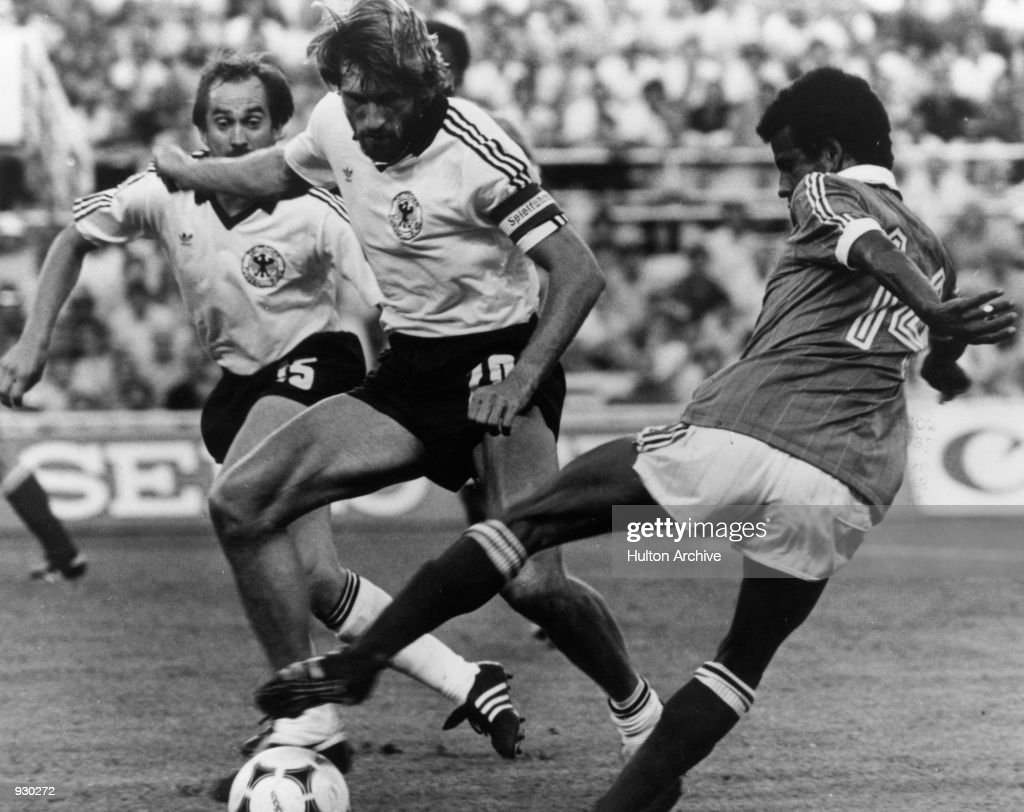 Jean Tigana of France uses his skill to take the ball past Manfred Kaltz of West Germany during the FIFA World Cup semi-final played at the Estadio Sanchez Pizjuan, in Seville, Spain. The match ended in a 3-3 draw after extra-time, West Germany won the match 5-4 on penalty kicks. \ Mandatory Credit: Allsport/Hulton\