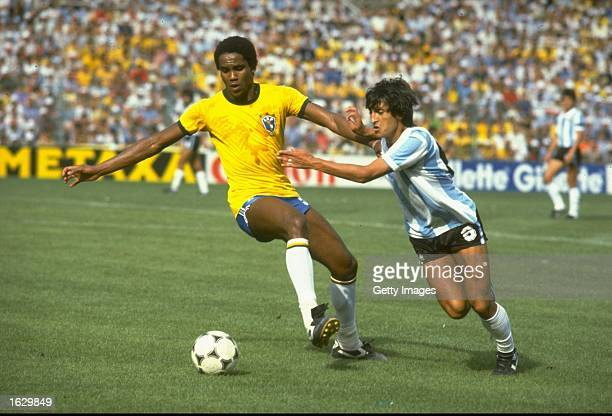 Serginho of Brazil takes on Ramon Diaz of Argentina during the World Cup Second Round match at the Sarria Stadium in Barcelona Spain Brazil won the...
