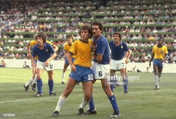 Zico of Brazil and Claudio Gentile of Italy mark each other during the World Cup Second Round match at the Sarria Stadium in Barcelona Spain Italy...