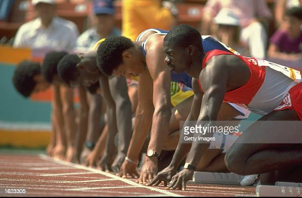 Ben Johnson of Canada lines up with the rest of the competitors at the start of the 100 metres event at the 1984 Olympic Games in Los Angeles USA...