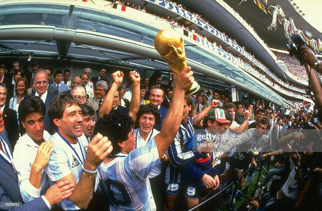 Diego Maradona of Argentina holds the trophy aloft after the World Cup final against West Germany at the Azteca Stadium in Mexico City. Argentina won the match 3-2. \ Mandatory Credit: Mike King/Allsport