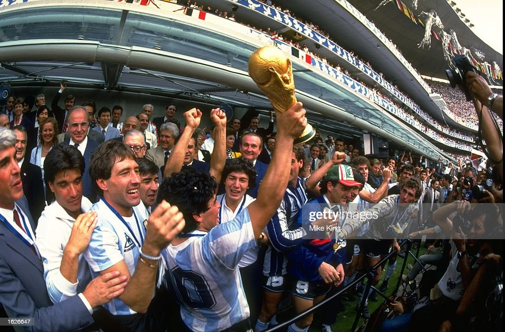 Diego Maradona of Argentina holds the World Cup trophy aloft after the 1986 World Cup final between Argentina and West Germany at the Azteca Stadium in Mexico City, Mexico. Argentina won the match 3-2. \ Mandatory Credit: Mike King/Allsport
