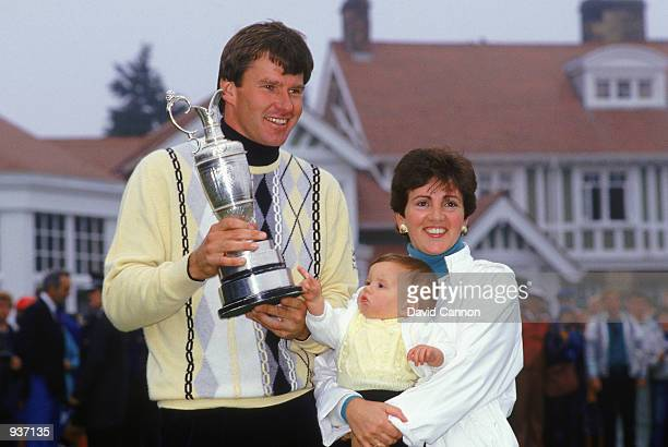 Nick Faldo of England holds the Claret Jug alongside his family wife Gill and baby Natalie after winning the British Open at Muirfield in Scotland...