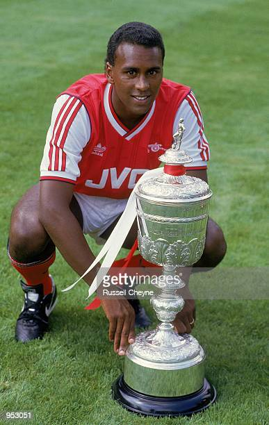 Portrait of David Rocastle of Arsenal posing with the Littlewoods Cup which Arsenal had won the season before during a photoshoot held at Highbury in...