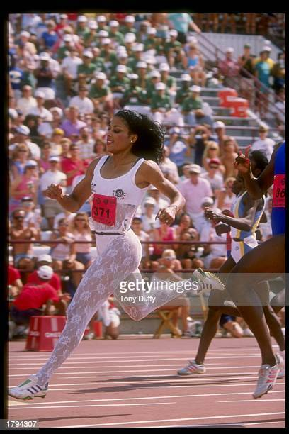 Florence GriffithJoyner runs down the track during the Olympic Trials