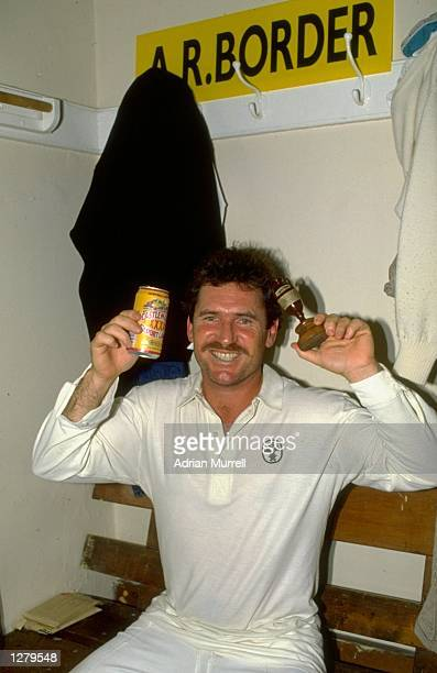 Allan Border of Australia holds up the ashes in the dressing room after the Sixth Test against England at the Oval in London The match ended in a...