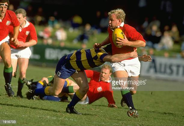 Andy Robinson of the British Lions dodges past the opposition during the British Lions Tour match between Canberra and the Lions in Canberra,...