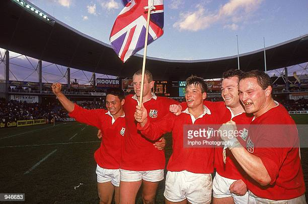 Rory Underwood Dean Richards Rob Andrew Ievan Evans and Brian Moore all of the British Lions celebrate victory after the third test match against...