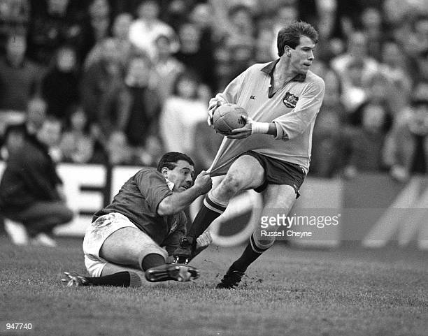 Scott Hastings of the British Lions tackles Ian Williams of Australia during the British Lions tour to Australia match played in Sydney Australia...