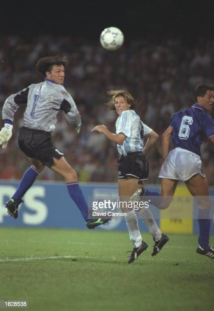 Claudio Canniggia of Argentina heads the ball past Walter Zenga the Italian goalkeeper during the World Cup SemiFinal at the San Paolo stadium in...