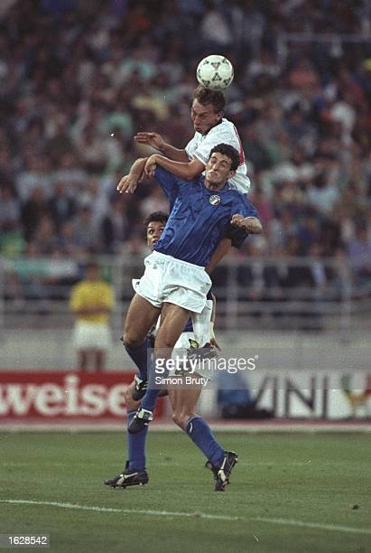 David Platt of England jumps above Ricardo Ferri of Italy during the World Cup Third Place match in Bari Italy Italy won the match 21 Mandatory...