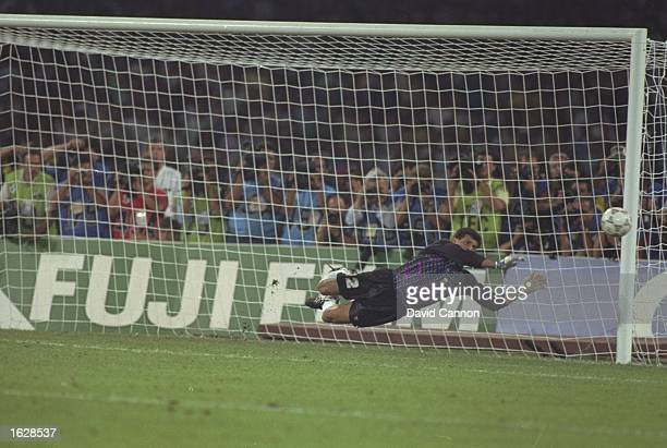 Goycoechea the Argentina goalkeeper saves the vital penalty during the World Cup SemiFinal against Italy at the San Paolo stadium in Naples Italy The...