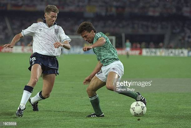 Lothar Matthaus of Germany takes on Chris Waddle of England during the World Cup semifinal at the Delle Alpi Stadium in Turin Italy Germany won the...