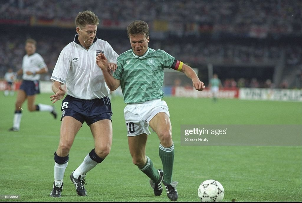 Lothar Matthaus of Germany and Chris Waddle of England : News Photo