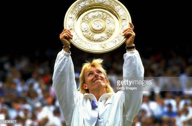 Martina Navratilova of the USA holds up the winners'' plate after winning the Wimbledon Championships played at Wimbledon London England Mandatory...