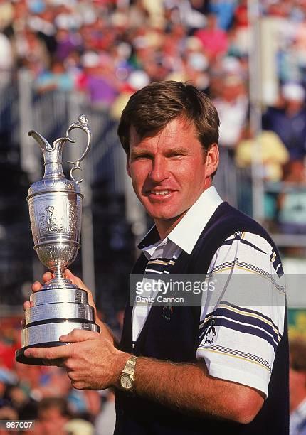 Nick Faldo of England holds aloft the Claret Jug after winning the British Open played at St Andrews in Fife Scotland Mandatory Credit David Cannon...