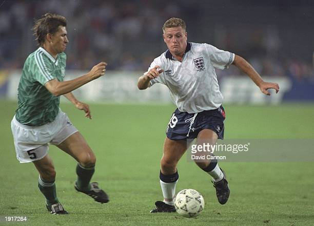 Paul Gascoigne of England takes on Klaus Augenthaler of West Germany during the World Cup semifinal at the Delle Alpi Stadium in Turin Italy West...