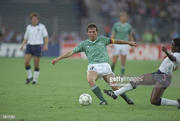 Paul Parker of England tackles Lothar Mattheus of West Germany during the World Cup semifinal at the Delle Alpi Stadium in Turin Italy West Germany...