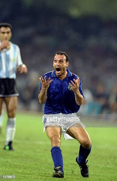 Salvatore Schillaci of Italy celebrates during the World Cup semifinal against Argentina at the San Paolo Stadium in Naples Italy Argentina won the...