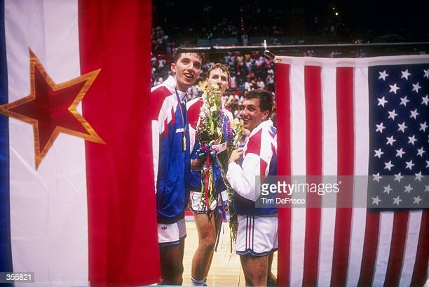 Team Yugoslavia celebrates as they receive their medals at the Goodwill Games Mandatory Credit Tim DeFrisco /Allsport