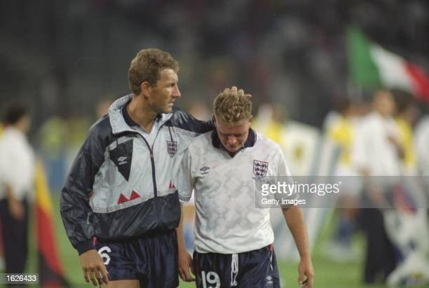 Terry Butcher of England consoles team mate Paul Gascoigne after the World Cup semifinal against West Germany at the Delle Alpi Stadium in Turin...