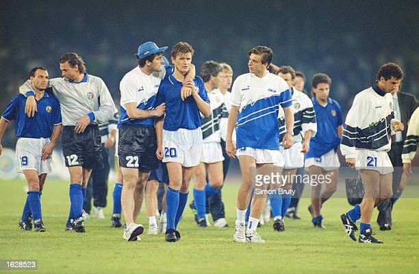 The Italian team look dejected after losing on penalty kicks during the World Cup SemiFinal against Argentina at the San Paolo stadium in Naples...