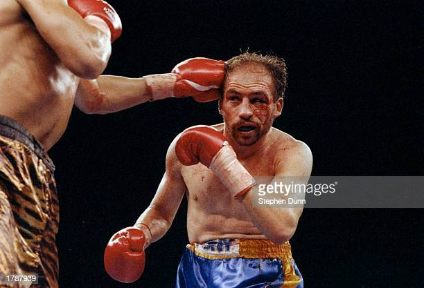 Lupe Gutierrez takes a punch to the head from opponent Tony Lopez during their fight at Lake Tahoe Nevada Mandatory Credit Stephen Dunn /Allsport