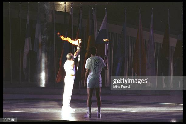 An archer lights the flame at the opening ceremony of the summer olympics in Barcelona, Spain. Mandatory Credit: Mike Powell/Allsport UK