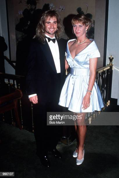 Andre Agassi of USA and Steffi Graf of Germany pose for photographers at the Champions Ball for the Wimbledon Tennis Championships Mandatory Credit...