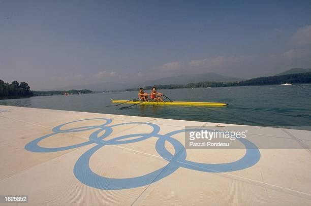 Dantchev and Bantchev of Bulgaria row past the Olympic Rings in the Double Skulls event during the 1992 Olympic Games in Barcelona Spain Mandatory...